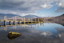 Wooden Jetty Lit Up On Derwent Water