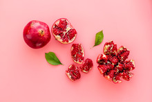 Cut Pomegranate With Ripe Seeds On Pink Background Top-down