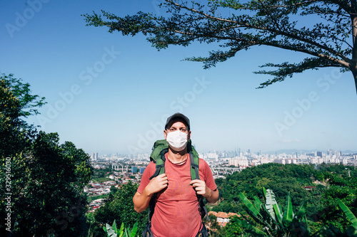 Fototapeta Man with mask and backpack outdoors obraz