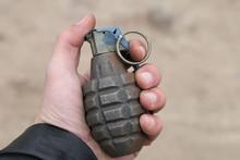 American Combat Grenade In Hand