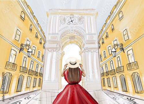 Woman in red dress and hat standing back in front of the famous triumphal arch in Lisbon city Canvas Print