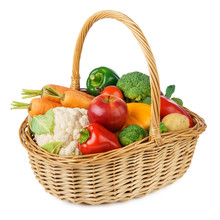 Fresh Fruits And Vegetables In A Wicker Basket. Isolated.