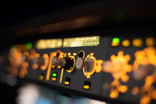 Close Up Shot Of The Flight Control Unit Of An Airbus A320 In Flight, Cockpit View At Night