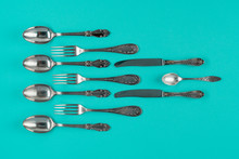 Cutlery, Forks, Spoons, And Knives On Blue Background, Flat Lay Or Top View.