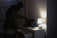 Burglar Stealing And Putting S...