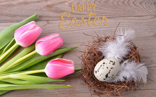 Easter Nest And Pink Tulips On...