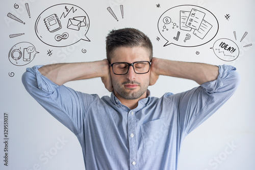 Manager trying to concentrate with hand drawn business sketches Fototapeta