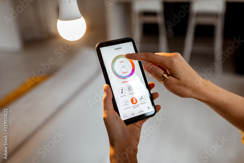 Controlling light bulb temperature and intensity with a smartphone application Wallpaper Mural