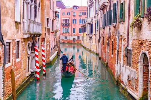 Obraz na plátne Traditional scenic canal street with venetian gondola in Venice, Veneto, Italy