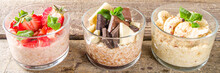 Set Various Fruit Overnight Oatmeal. Oats Porridge With Strawberry, Bananas, Chocolate, Nuts In Small Portion Jars. Summer Breakfast Oatmeal. Healthy Vegan Diet Snack.