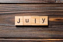 July Word Written On Wood Bloc...
