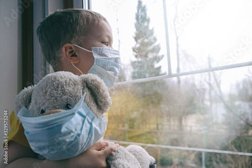 Sad illness child on home quarantine Tablou Canvas