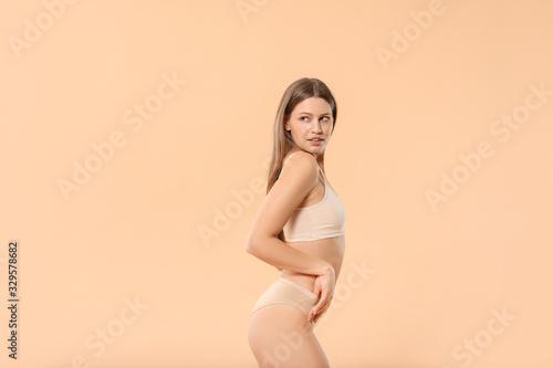 Fototapeta Beautiful young woman in underwear on color background obraz na płótnie