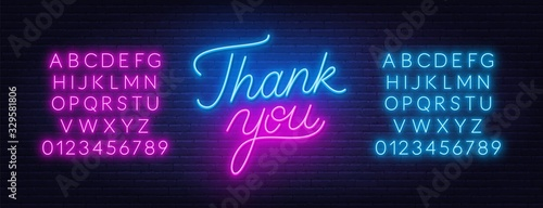 Fotografie, Obraz Thank you neon lettering on brick wall background