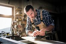 Carpenter Working On Woodworki...