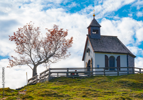 Autumn landscape, Styria, Austria - The old beautiful chapel on the Postalm, on an autumn day in golden October with blue sky Fototapete