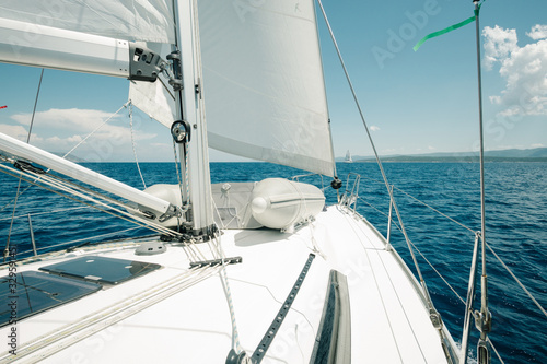 Ship deck on a yacht on the sea with blue sky. Sailing and yachting concept.