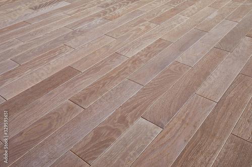 Fototapeta Natural wooden texture. New oak parquet. Wooden laminate floor boards background image. Polished oak pattern. obraz na płótnie