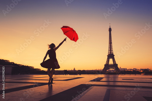 tourist travel to Paris, silhouette of happy woman with red umbrella near Eiffel Tower