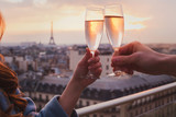 Fototapeta Fototapety Paryż - couple drinking champagne or wine in Paris luxurious restaurant with view of Eiffel tower, luxury romantic getaway honeymoon