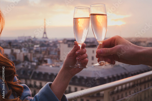 couple drinking champagne or wine in Paris luxurious restaurant with view of Eif Fototapeta