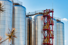 Detail Of Beer Production Plant. Large Amount Of Fermentation Tanks.