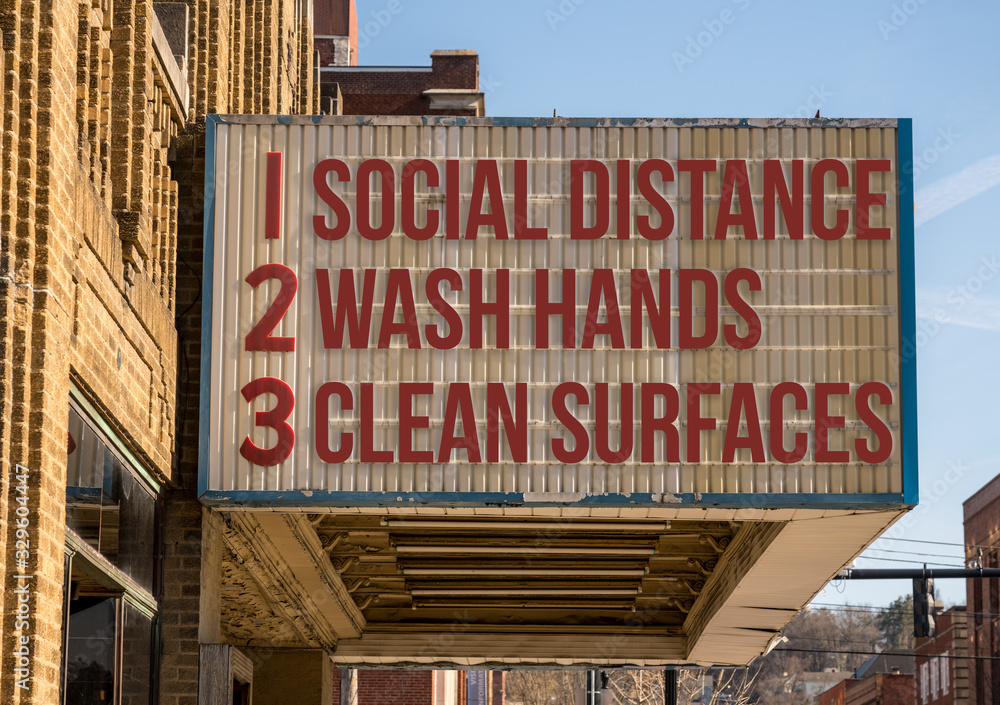 Fototapeta A photo illustration of a movie cinema billboard with three basic rules to avoid the coronavirus or Covid-19 epidemic of wash hands, maintain social distance and clean surfaces