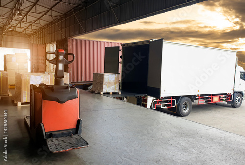 Obraz Truck container docking load shipment goods at warehouse, forklift   pallet jack with stack package boxes on pallet, road freight industry delivery logistics and transport. - fototapety do salonu