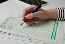 Close Up Of Filing A Tax Declaration With A Pen