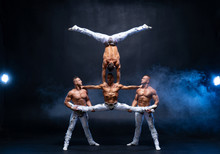 Four Muscular Man Perform Diff...