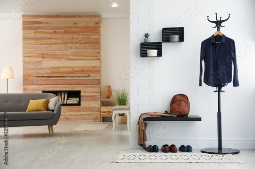 Photo Hallway interior with stylish furniture, clothes and accessories