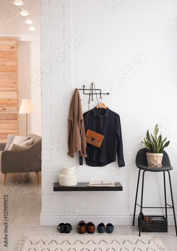 Hallway interior with stylish furniture, clothes and accessories Wallpaper Mural