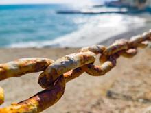 Rusty Chain On Blurred Backgro...