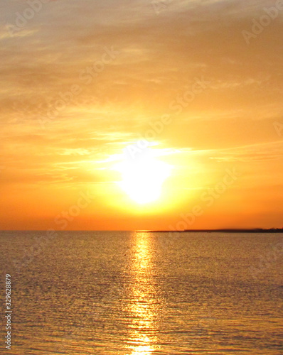 huge bright sun over the horizon in early spring