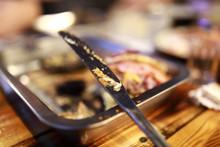 Knife With Leftover Food On Pl...