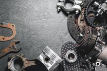 Old Car Spare Parts On Dark Fl...