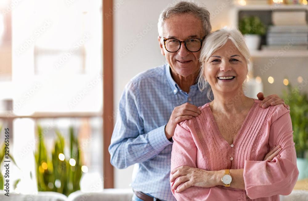Fototapeta Portrait of a happy senior couple at home