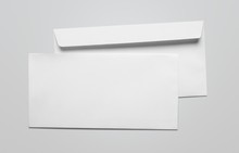 Blank Card And White Envelope On The Desk