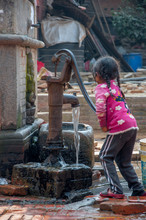 Little Girl Getting Water From...