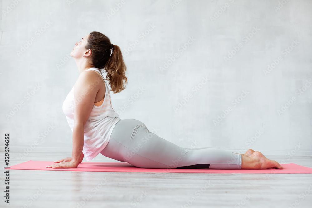 Fototapeta Lovely woman doing stretching or yoga exercise