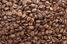 Close Up Of Raw Coffee Beans O...