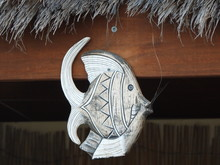 Fish Carving Statue On Wooden Background