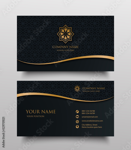 Fotografía business card with gold floral ornamental logo and place for text on dark backgr