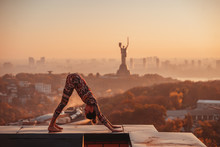 Woman Doing Yoga On The Roof O...
