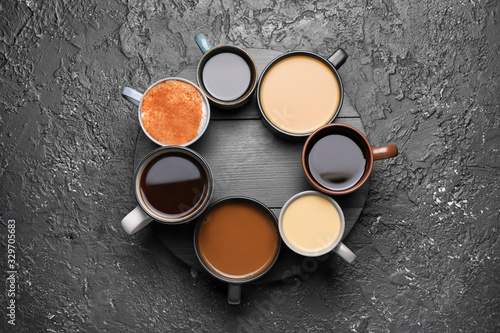 Obraz Composition with cups of different coffee on grunge background - fototapety do salonu