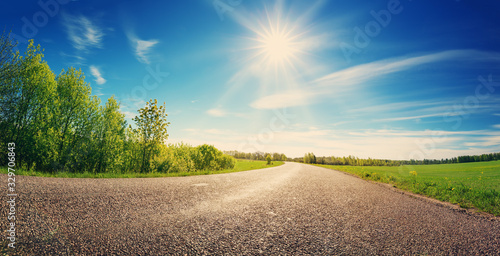 Fototapeta asphalt road panorama in countryside on sunny spring day obraz