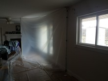 Plastic Or Containment Area In Home Or House With Windows