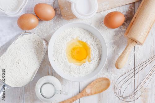 Carta da parati Homemade Dough Recipe (Eggs, flour, milk, sugar) and wooden kneading dough on a