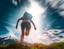 Young Woman Hiker Runs On The ...