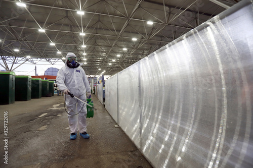 """Disinfection and decontamination on a marketplace """"Krasno selo"""" as a prevention Wallpaper Mural"""